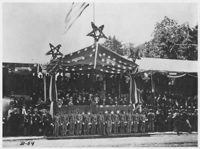 Mathew B Brady Collection of Civil War Photographs › B-54 Grand Review, 1865. Washington, Showing Reviewing Stand with General Grant, & President Johnson & Cabinet. - Fold3.com