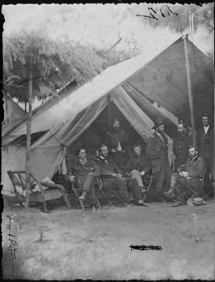 Mathew B Brady Collection of Civil War Photographs › B-2 General Ulysses S. Grant and Staff of Eight; Recognized: - Capt. William. Mck. Dunn, Colonel Ely S. Parker, General John A. Rawlins. - Fold3.com