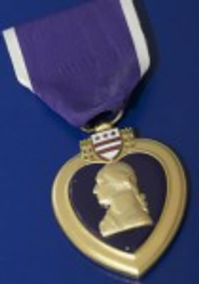 Purple Heart for Injuries sustained in an armed comflict battle.
