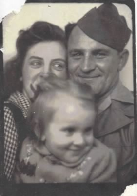 Dad when he was in the service with Mom and Margee