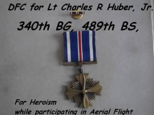 340thBG, 489thBDS, Lt Charlie Huber, Jr. earned a DFC for Heroism during Aerial Flight.