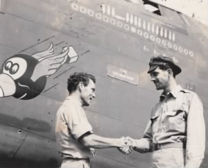 T/Sgt Morton shakes hands with William D. Doc Hughes