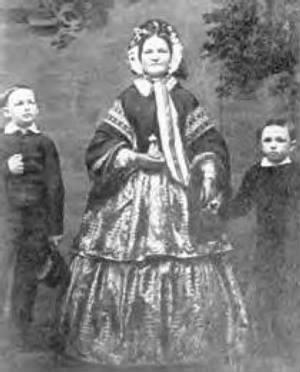 Mary Todd Lincoln with Willie (left) and Tad (right)