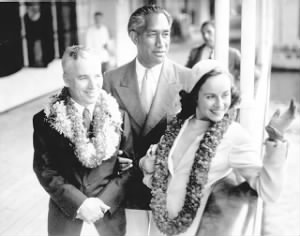 Duke Kahanamoku, with Charlie Chaplin and Chaplin's wife Paulette Goddard, 1938..jpg