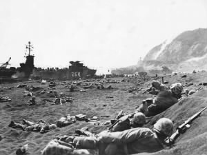 Marines burrow in the volcanic sand on the beach of Iwo_Jima.jpg